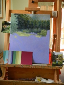 painting on easel with selected color paper swatches