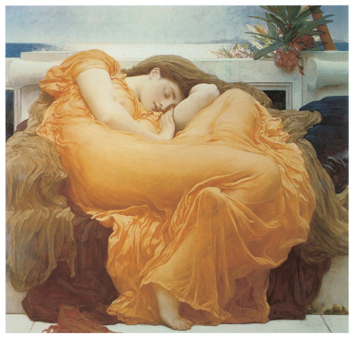 Woman asleep curled on a chair in a flowing orange gown