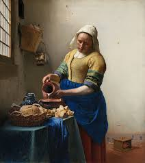 Painting of woman pouring milk from a pitcher in a Dutch kitchen