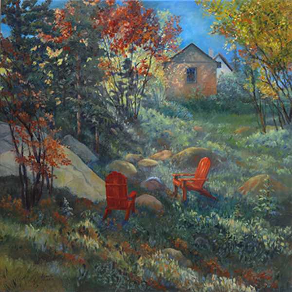 Hillside garden with two red adirondack chairs